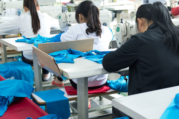 Young women working in a sweat shop