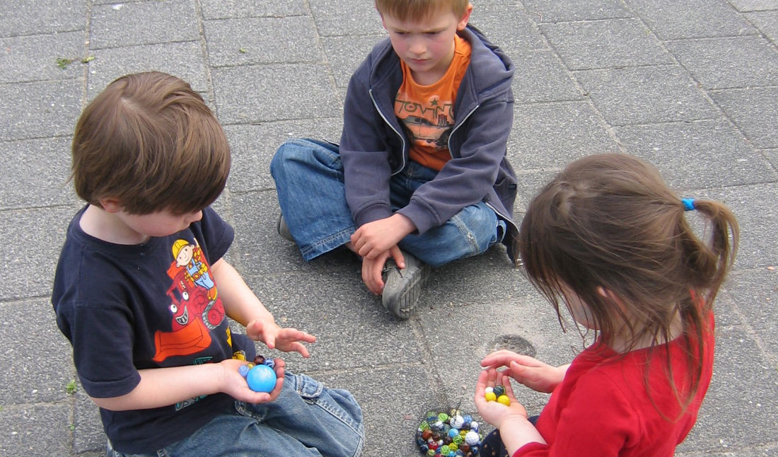 Children negotiating marbles