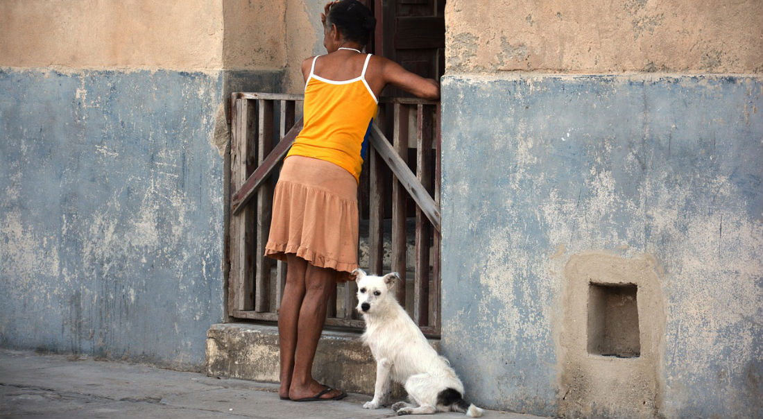 Cuban woman and dog