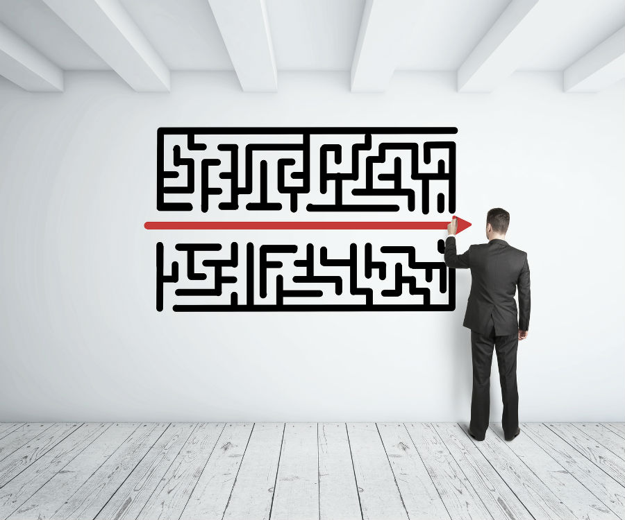bigstock-Man-Drawing-Maze-53939659